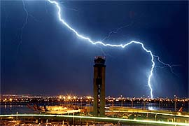 Lightning strikes near an airport air traffic control tower