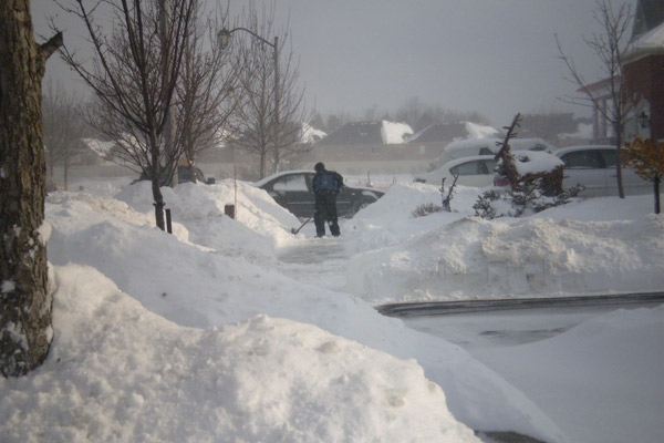 A man shovels snow in his driveway in Ontario, Canada December 21, 2008.  Credit:  Sumran Bhan / CTV.ca