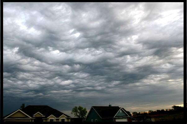 Turbulent motions between differing air masses create undulating clouds over Kansas in 2006.  Meteorologists are proposing these clouds be designated as the first new cloud type to be named in over 50 years:  Undulus Asperatus.