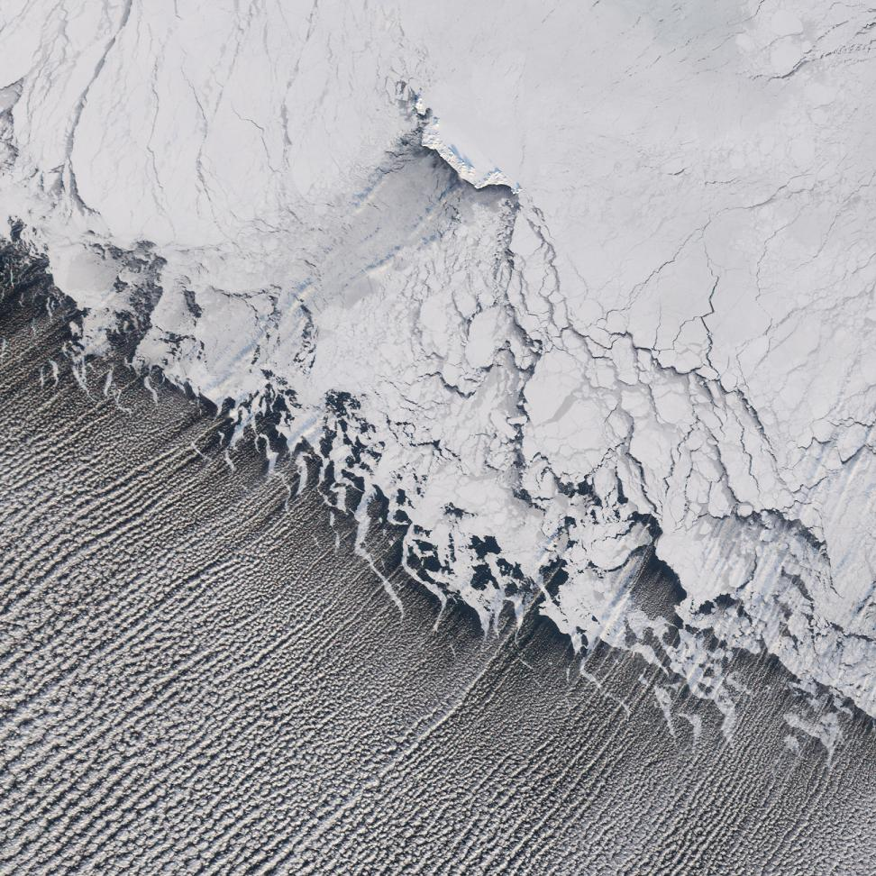 Cloud Streets form over the Bering Sea as cold air flows from over the snow-covered continental surface (white land mass) and over open ocean waters.  The open ocean waters warm the air from beneath, causing rising motion that cools the air, condenses the water droplets, and forms clouds.  Image Source:  NASA MODIS.