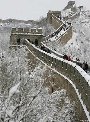Snow blankets a stretch of the Great Wall of China in this file photo.  Chinese Government officials have claimed recent successes in seeding clouds to produce snowfall in and around Beijing as a means of alleviating drought.