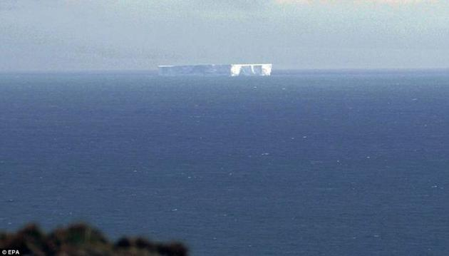 This massive iceberg drifts off the coast of Macquarie Island south of Australia, promising tourists and beach-goers an amazing sight should it drift closer.  Scientists expect the iceberg to slowly shrink and break apart in warmer ocean waters.
