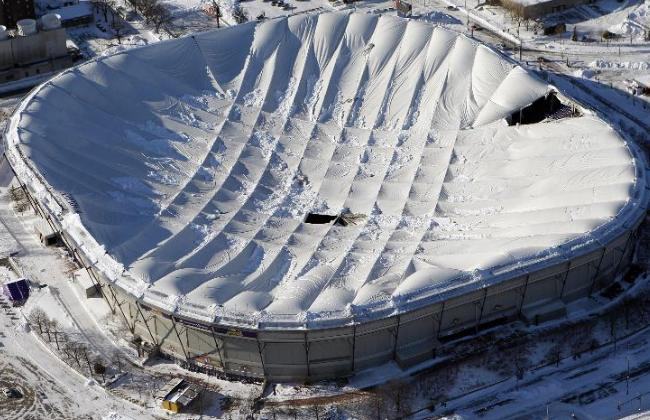 "Over 17"" of freshly-fallen snow collapsed the roof of the Minneapolis Metrodome-home of the Minnesota Vikings."