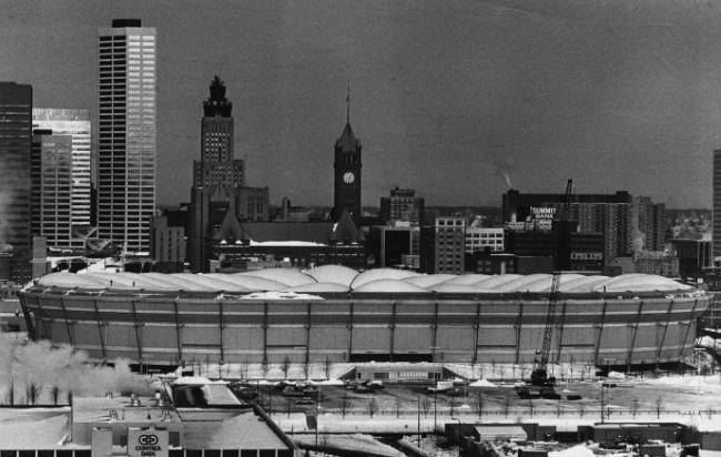 This photo from several blocks away shows the flattened roof of the Metrodome-an unusual sight for residents used to the familiar inflated bubble appearing on the skyline.